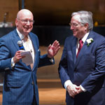 President William L. Henrich, M.D., MACP, shares a light moment with James L. (Larry) Holly, M.D., in the renovated auditorium. Dr. Holly is a 1973 alumnus of the School of Medicine and served as president of the school's alumni association from 2006 to 2010.